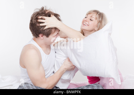 Couple having a pillow fight - Stock Photo
