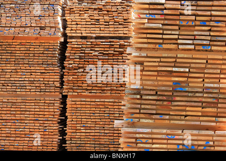 Planks of wood for pallets stacked - Stock Photo