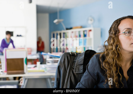 Woman working in office - Stockfoto