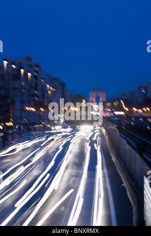 Light trails from traffic on busy urban freeway - Stock Photo