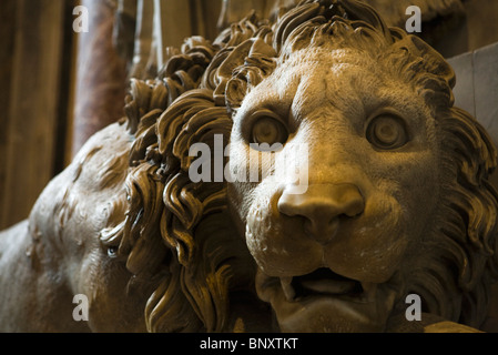 Statue of vigilant lion flanking Monument to Pope Clement XIII, St. Peter's Basilica, Rome, Italy - Stock Photo