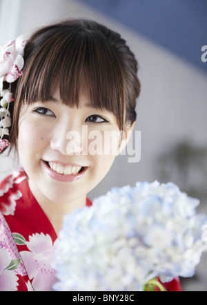 Hydrangea and young woman - Stock Photo
