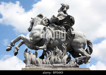 Equestrian statue of Louis XIV in the Cour Napoleon of the Palais du Louvre, Paris, France. - Stock Photo