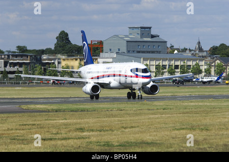 Sukhoi Superjet 100 taxiing onto the runway at the Farnborough Airshow - Stock Photo