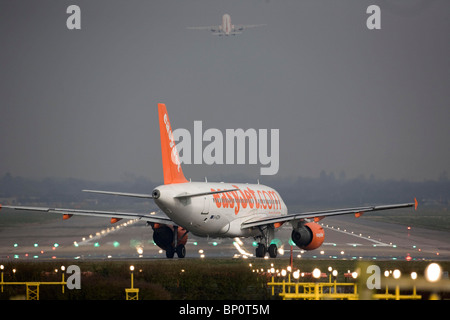 A EasyJet aircraft  taxis onto the runway at Gatwick Airport.Picture by James Boardman - Stock Photo