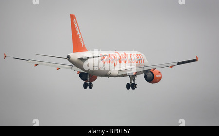 A EasyJet aircraft comes into land at London's Gatwick Airport. Picture by James Boardman - Stock Photo