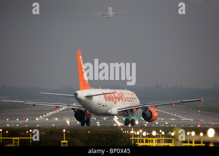 A EasyJet aircraft  prepares to take off from London's Gatwick Airport. Picture by James Boardman - Stock Photo