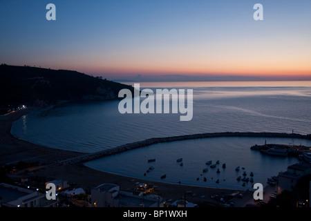 Sunset over Peschici harbor, Puglia, Italy - Stock Photo