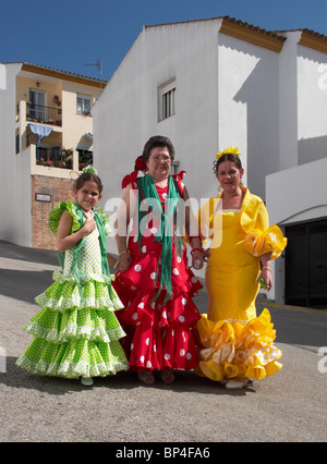 Women in traditional flamenco dress. Prado del Rey, Sierra de Cadiz, Andalucia, Spain. - Stock Photo