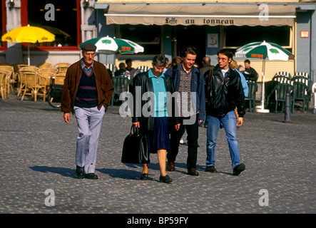 Belgian people mother and father and two sons family walking together in Grand Place city of Mons Walloon Region - Stock Photo