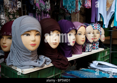A variety of colors, textures, and fabrics of Muslim headscarves on sales display in a shop in Jerusalem's Old City. - Stock Photo