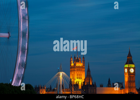 Millennium wheel and Houses of Parliament at dusk, London, UK. - Stock Photo