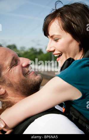 A happy couple hugging - Stock Photo