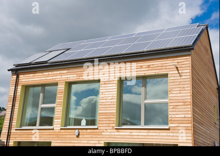 Timber clad zero carbon passive house with triple glazed windows & roof covered with solar panels for electricity - Stock Photo