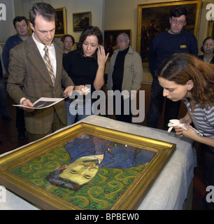 Experts examine painting by Vincent van Gogh which returned from Switzerland - Stock Photo
