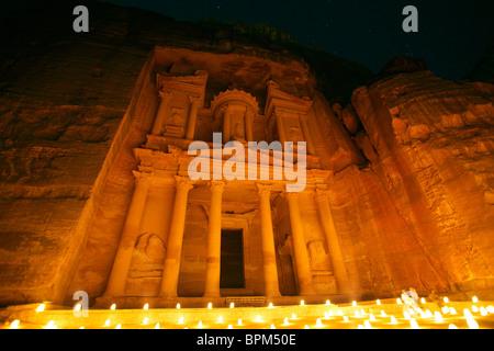 Al Khazneh (or Treasury) by night illuminated by candlelight, Petra, Jordan - Stock Photo