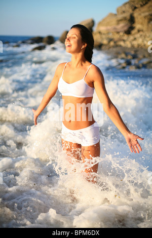 happy beautiful girl in the sea waves - Stock Photo