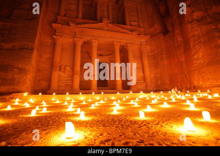 Al Khazneh (or Treasury) by night illuminated by candlelight, Petra, Jordan - Stock Photo