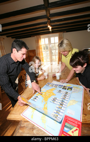 Image shows a family looking at a map of New Zealand where they plan to emigrate to. Photo:Jeff Gilbert - Stock Photo