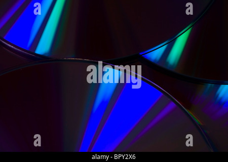 Many colorful DVD lying upon each other - landscape format - Stock Photo