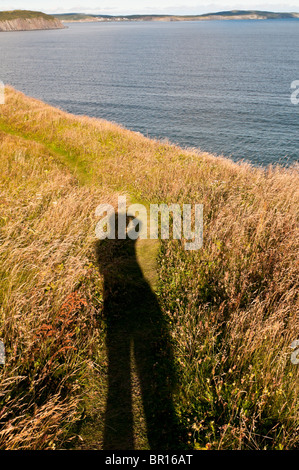 Long shadow of photographer in late afternoon light, Sherwink Trail, near Trinity East, Newfoundland, Canada - Stock Photo