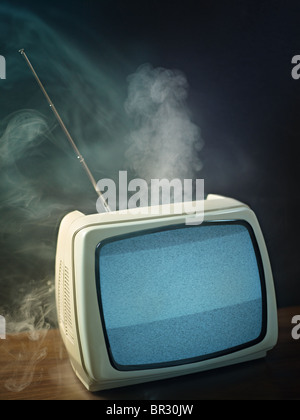 broken tv about to explode. Studio shot, vertical shape, copy space - Stockfoto