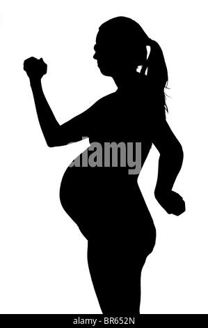 pregnant woman with props and black bathing suit on white background. - Stock Photo