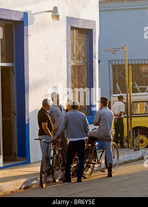 A group of local men meet in the morning street in San Antonio de los Ba–os Cuba. - Stock Photo