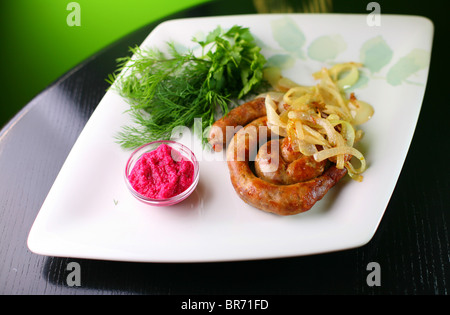 fry sausages - Stock Photo
