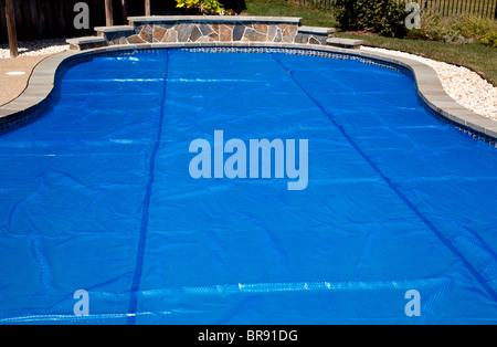 Domestic swimming pool with blue solar bubble wrap cover - Domestic swimming pools ...