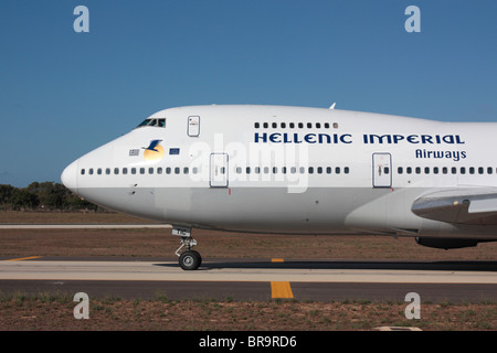 Hellenic Imperial Airways Boeing 747-200 taxiing for departure - Stock Photo