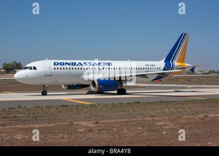 Donbassaero Airbus A320 taxiing for departure - Stock Photo