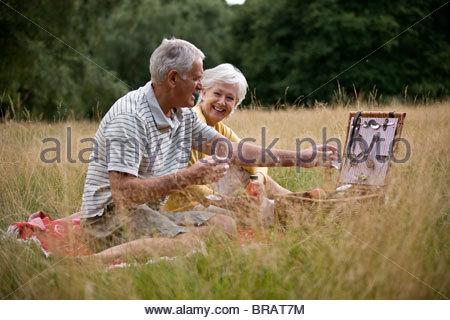 A senior couple having a picnic - Stock Photo