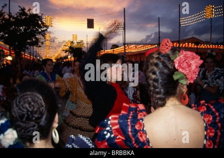 Spain Andalucia Seville Female Flamenco Dancers Dancing in Street At Sunset In Traditional Costume During The April - Stock Photo