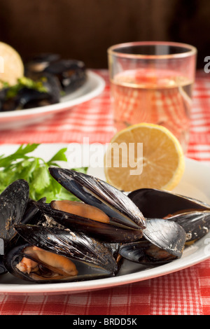 Mussels with Lemon, Parsley and Wine - Stock Photo