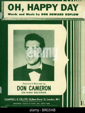 DON CAMERON   UK singer on sheet music of the huge 1952 hit Oh, Happy Day  by US songwriter Don Koplow - Stock Photo