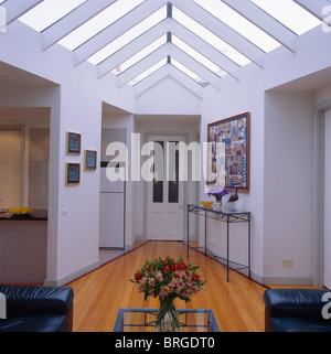 Hall with staircase and console table in converted ...