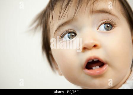 Baby looking away, portrait - Stock Photo