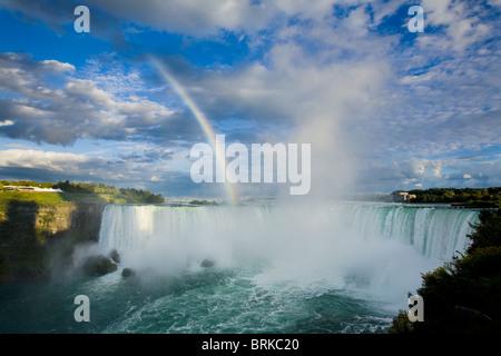 Rainbow and spectacular clouds over Horseshoe Falls, Niagara Falls, Ontario, Canada - Stock Photo