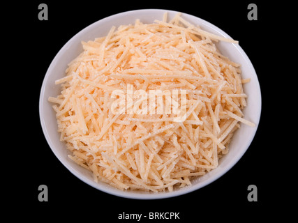 one small prep bowl of shredded cheddar cheese ready to cook with over a black background - Stock Photo
