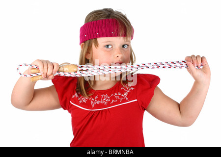 Small girl holding her jump rope isolated on white - Stockfoto