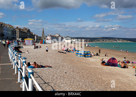 The beach and Esplanade in Weymouth - Stock Photo