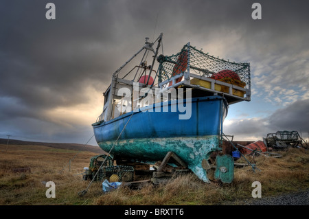 Fishing Boat taken out of water for repair Shetland - Stock Photo