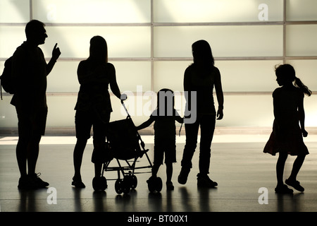 Silhouettes of parents and a child - Stock Photo
