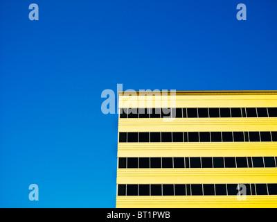 Modern building exterior against blue sky - Stock Photo