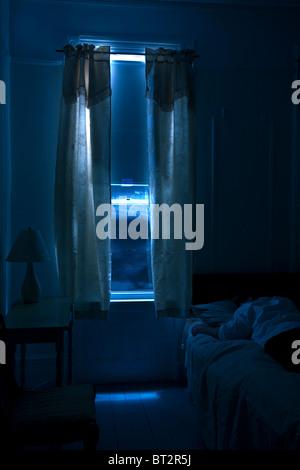 interior hotel room , man sleeping, monochromatic, dark, mystery, suspense,night - Stock Photo