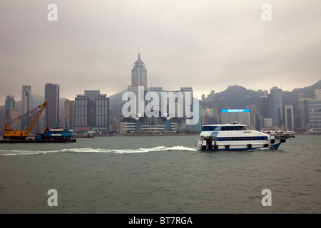 The amazing Hong Kong skyline as seen from Victoria Harbour  imposing structures include the Central Plazza & Convention - Stock Photo
