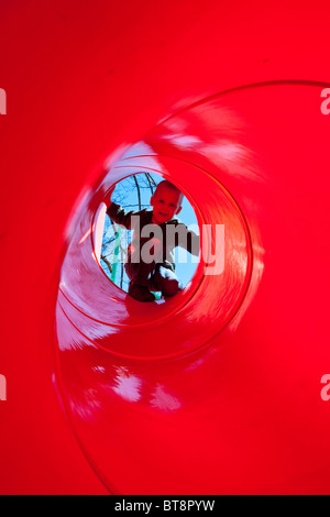 Young boy in a slide at a park in South Orange, New Jersey - Stock Photo