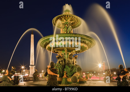 Blue Hour in Paris on Place de la Concorde, with the Obelisik and Eiffeltower - Stock Photo