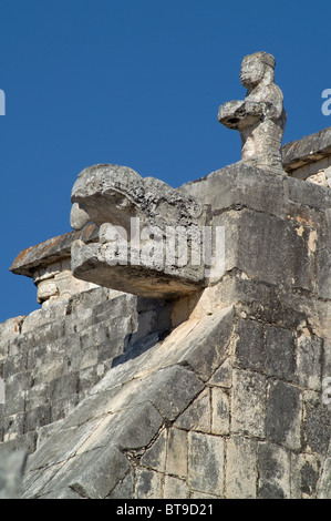 Warrior and serpent head at the Temple of the Warriors (Group of a Thousand Columns).Maya Site of Chichén Itzá, - Stock Photo